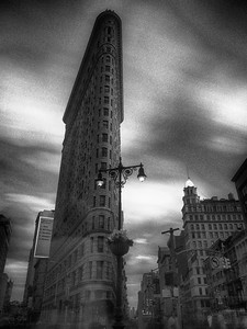 On a cloudy day while in New York City, a friend and I decided to spend an evening shooting one of my favorite buildings in the world, the Flatiron building. I decided to use some ND filters on the lens, so the exposure time was very high. Unfortunately, there weren't many contrasting clouds in the sky (and it was just an overall gray overcast), though that may have distracted from the image too much. This is with a 60 second exposure about 2 hours prior to sunset.