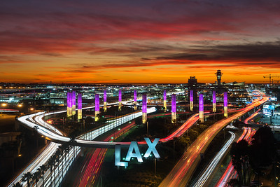 Kobe Tribute lights at LAX with purple and gold at sunset