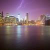 Lightning strikes One World Trade Center in downtown Manhattan during a summer storm