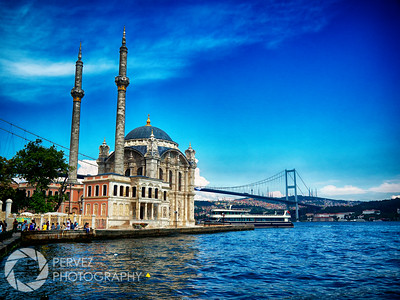 Ortakoy Mosque in Istanbul, with the Bosphorus Bridge in the background. I'd been looking for this mosque for over a year - I didn't get a chance to shoot it the previous summer I was in Istanbul, so I made a point to find it the next year I was there. The mosque itself is quite beautiful, and the bridge and water in the background really make the shot incredible. I hopped on a ferry that was supposed to stop there for a few minutes, and then head further down the Bosphorus. Of course, they stopped for literally 20 seconds, and I was stuck on the ferry until it came back an hour later. The sky was dark at this time, too, as thunderstorms hit within minutes. I still wonder what could have been had the ferry stopped for the right time and I got this photo with storm clouds in the sky. Oh well. When the ferry finally made its way back, I was waiting at the gate, and jumped out immediately. Of course, the ferry left after 20 seconds, again (they really don't get what 3 minutes is, apparently). At this point, I went ahead and got my photos, and dealt with figuring out how to make my way across the city afterwards. I took a good 20 minutes taking shots - the view is so fantastic that they all looked great. This is a case of a scene living up to the hype for a photographer. The only thing missing were birds that often fly around this mosque, but you can't win them all.