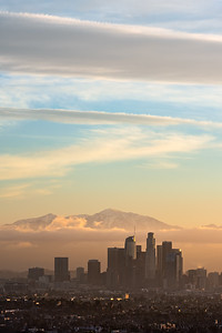 Los Angeles sunrise with low fog and snow covered San Gabriel mountains