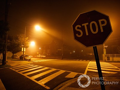 Stop sign in a foggy night in Petworth neighborhood in Washington, DC.