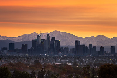 Sunrise burn over Los Angeles and snow capped San Gabriel mountains after a storm