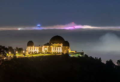 Griffith observatory and foggy Los Angeles tips lit by Dodgers blue