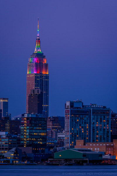 Empire State Building celebrating Gay Pried by lighting up in rainbow colors.