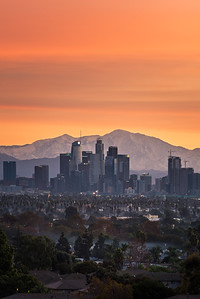 Los Angeles sunrise burn with snow capped mountains
