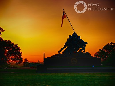 Sunrise at the Iwo Jima Memorial in Virginia, with DC in the background, on Memorial Day. We got up at 4 am to head out from DC to Virginia to grab this shot. The first stop was on the National Mall, but once we realized the light wasn't going to reflect very well off the Reflecting Pool in front of the Lincoln Memorial, we hightailed it to Virginia to get this shot before the sun came up. Given how crowded these areas are during weekends, especially Memorial Day weekend, it was unique to have the space practically to ourselves to position our shots as we saw fit. There were a handful of photographers out, but it was practically empty. As the sun started rising, the sky turned a fantastic red/orange, and I frantically took shots and moved around with my tripod to get a handful of photos from different perspectives. You only have a few minutes to get this kind of light, so hey, make the best of it!