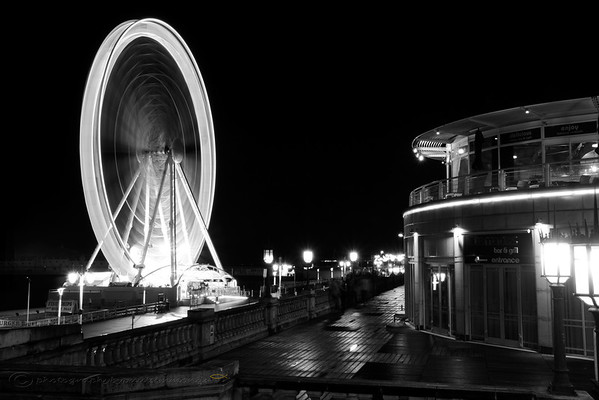 A black and white version of the Brighton wheel captured in motion one winters night