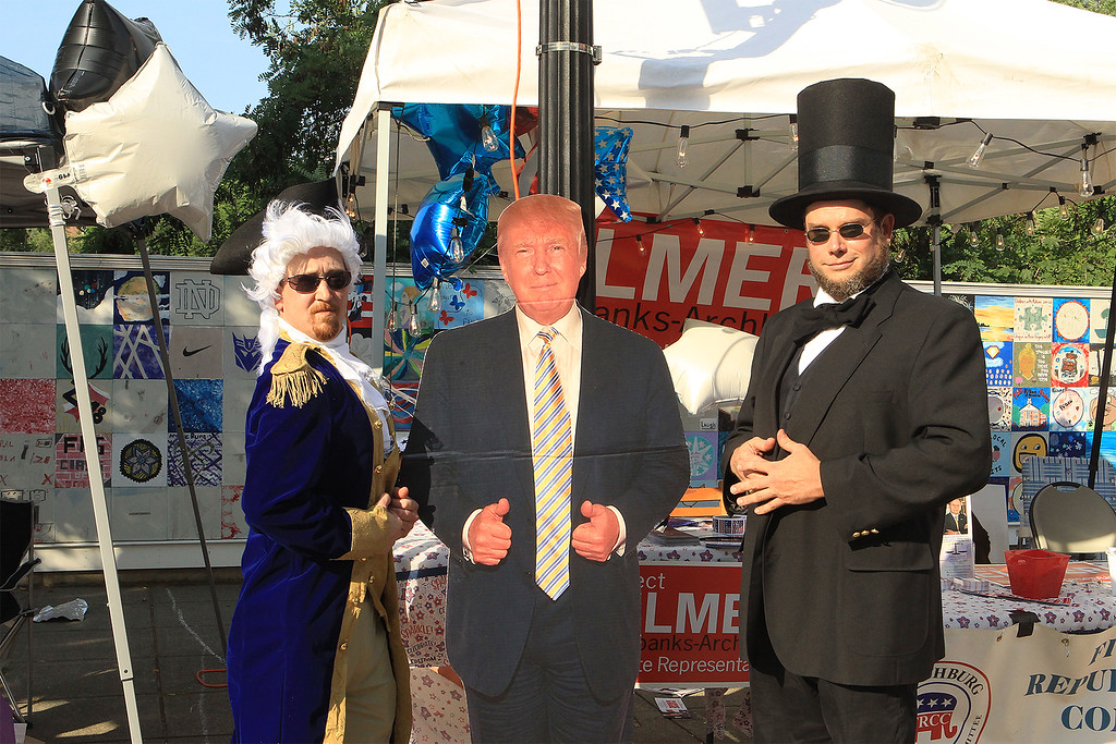 . George Washington aka Andrew Couture, Donald Trump and Abraham Lincoln aka Michael Barth share a few words at Civic Day SENTINEL&ENTERPRISE/Scott LaPrade