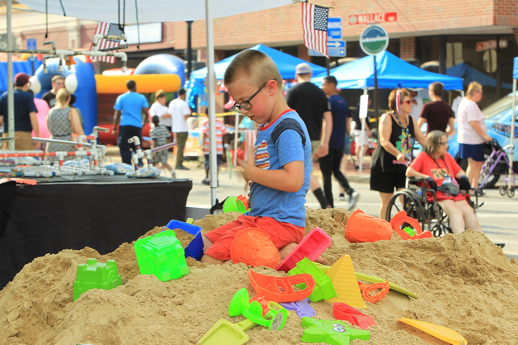 . Julian Downs 5 yrs of Fitchburg enjoying the sand pile at Civic Day SENTINEL&ENTERPRISE/Scott LaPrade