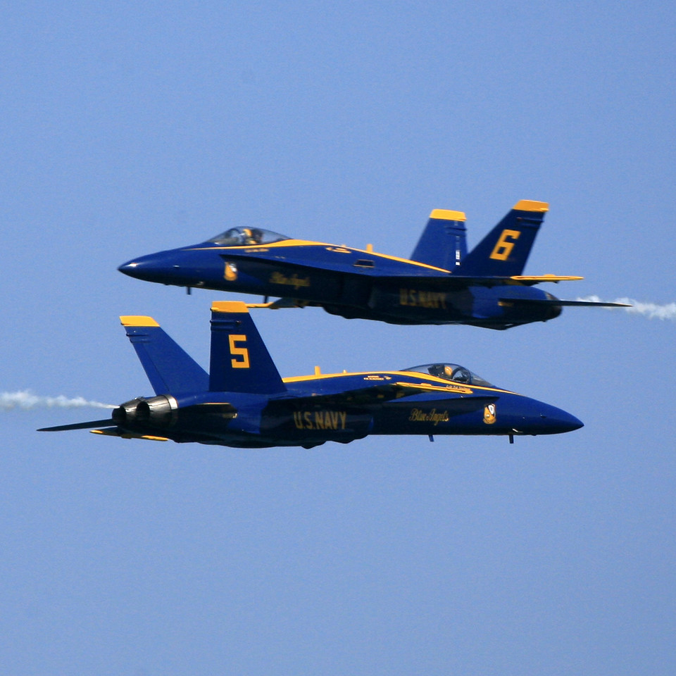 "These two Blue Angels are flying at each other at 550 mph. That computes to 1100 mph relative to these Jet. I am ""panning"" left to right following Jet #5; at the instant that I noticed the nose of the #6 Jet I captured the moment. Pretty lucky this time. I've been to all of the shows for the past 5 years and have not been able to pair-them like this shot.  The camera was set to A-priority at F7.0 with ISO 320, so the resultant shutter speed was 1/3200 per second to ""freeze"" as best as possible yet giving depth of field to capture both Jets.<br /> <br /> The Fort Lauderdale Air and Sea Show is held every year in Fort Lauderdale on the beach and is a free event over 2 days inearly May. There are lots of USA militaty planes such as F14, 15,16 and 18. B1 Lancer plus stunt planes, AA777 plus lots more, too many to mention. The Thunderbirds round up the show each day.Plenty of cheap consessions with food from everywhere in the world.The show is totally free and is one of the biggest spectator events in the world with over 2 million people attending. All 4 military branches are there and you can ride simulators and take part in various events under instruction by the US marines. Lasts about 8 hours a day."