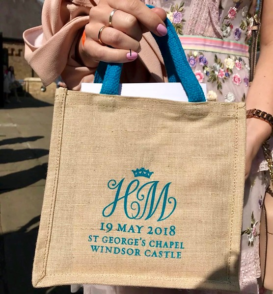 "Harry and Meghan, the Duke and Duchess of Sussex, invited 600 people to attend their wedding at St. George's Chapel at Windsor Castle; the two also invited 1,200 people to gather outside of the chapel to witness their wedding ceremony.  Those outside the chapel were given commemorative gift bags full of goodies such as a gold wrapped chocolate coin with the couple's initials, a water bottle, shortbread, a magnet featuring the wedding date and the initials ""H"" and ""M,"" as well as a coupon to a local store."