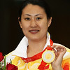 Olympics+Day+5+Shooting+Chen Ying of China poses with her gold medal after the Women's 25m Pistol shooting at the Shooting Range CTF during Day 5 of the Beijing 2008 Olympic Games