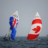 Olympics+Day+5+Sailing+Nathan Outteridge (L) and Ben Austin of Australia and Gordon Cook and Ben Remocker of Canada compete in the 49er class race held at the Qingdao Olympic Sailing Center