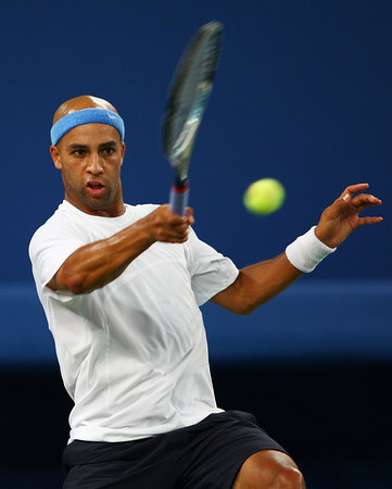 Olympics+Day+8+Tennis+James Blake of the United States returns a forehand to Novak Djokovic of Serbia during the men's singles bronze medal tennis match at the Olympic Green Tennis Center