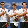 Olympics+Day+3+Archery+Park Kyung-Mo, Lee Chang-Hwan and Im Dong-Hyun of South Korea salute their National Anthem during the medal ceremony after winning gold medal in the men's archery