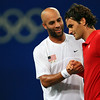Olympics+Day+6+Tennis+James Blake of the United States shakes hands with Roger Federer of Switzerland after Blake won in the men's tennis quarterfinals at the Olympic Green Tennis Centre