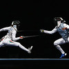 Olympics+Day+8+Fencing+Erinn Smart (R) of the United States competes against Edina Knapek of Hungary in the Women's Team Foil Semi Final at the Fencing Hall on Day 8 of the Beijing 2008 Olympic Games