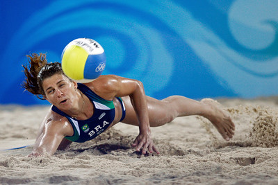 Olympics+Day+3+Beach+Volleyball+Larissa Franca of Brazil dives for a ball against Natalia Uryadova and Alexandra Shiryaeva of Russia during the beach volleyball event at the Chaoyang Park Beach Volleyball