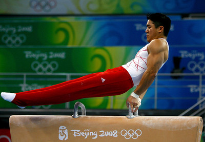 Olympics+Previews+Day+2+Kevin Tan of the United States performs on the pommel horse during a practice session ahead of the Beijing 2008 Olympics at National Indoor Stadium