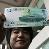 China+Releases+New+Bank+Note+Olympics+China's central bank has issued a commemorative 10-yuan US $1 46 note, which features an image of the National Stadium, or the Birds Nest