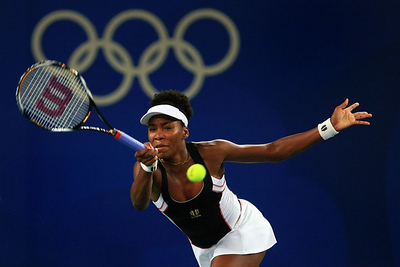 Olympics+Day+6+Tennis+Venus Williams of the United States returns to Li Na of China during the women's tennis quarterfinals at the Olympic Green Tennis Centre