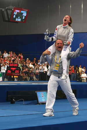 Olympics+Day+3+Fencing+Maria Valentina Vezzali of Italy is carried on the shoulders of her coach Andrea Magro after winning the women's fencing individual foil gold medal match