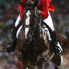 Olympics+Day+9+Equestrian+McLain Ward of the United States and Sapphire jump a fence during the Jumping Individual 2nd Qualifier held at the Hong Kong Olympic Equestrian Venue in Sha Tin
