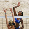 Olympics+Day+4+Beach+Volleyball+Tamara Larrea of Cuba shoots as Kerri Walsh of the USA attempts to block in the Women's Preliminary Pool B match