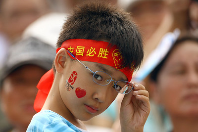 Olympics+Day+5+Hockey+A Chinese fan watches the South Korea and China men's pool hockey match at the Olympic Green Hockey Field during Day 5 of the Beijing 2008 Olympic Games