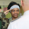 Memorial Middle School eighth grader Bejannell Hills, 13, salutes Captain Patrick Bucklin as she and members of  the Civil Air Patrol club at the school go through some marching drills on May 2, 2017. SENTINEL & ENTERPRISE/JOHN LOVE