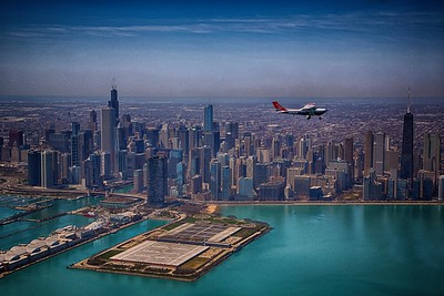 A Civil Air Patrol Cessna 182 flying over the Chicago Skyline