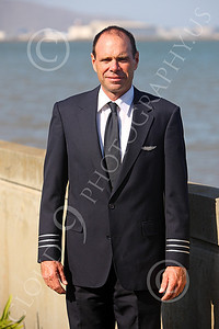 ALCPILOT 00001 Ed McDemott, an ASTAR Air Cargo DC-8 co-pilot, on his way to work at SFO, stands at the seawall in his uniform, by Peter J Mancus