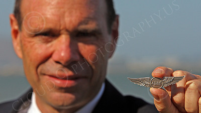 ALCPILOT 00004 Ed McDermott, an ASTAR Air Cargo Douglas DC-8 jet cargo co-pilot, at SFO, holds up his wings, which he earned via hard work and is justifiedly proud, by Peter J Mancus