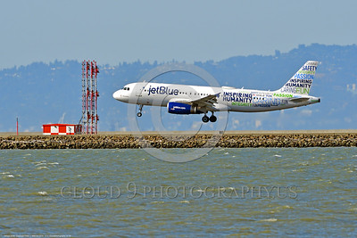 A320 00030 An Airbus A320 JET BLUE N598JB jet airliner with a rare color scheme lands at SFO 6-2016 jet airliner picture by Peter J  Mancus