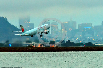 A320 00026 An Airbus A320 AIR CANADA jet airliner climbs out after take-off at SFO at night 6-2016 jet airliner picture by Peter J  Mancus