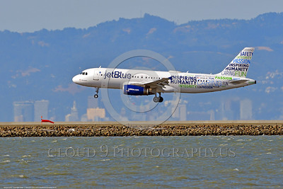 A320 00002 An Airbus A320 JET BLUE N598JB jet airliner with a rare color scheme lands at SFO 6-2016 jet airliner picture by Peter J  Mancus