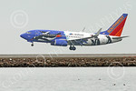Boeing 737 00178 A colorful Southwest Airline Boeing 737 PENQUIN SEA WORLD on final approach to land at SFO 12-2014 airliner picture by Peter J Mancus