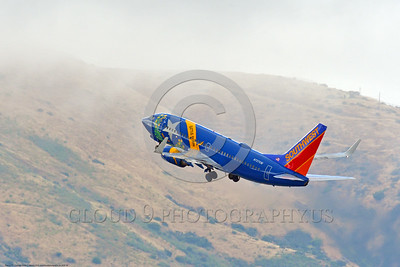 "B737 00006 A colorful Boeing 737 Southwest Airline N727SW Nevada ""BATTLE BORN"" ""Easter Egg"" climbs out after take-off San Francisco 6-2016 airliner picture by Peter J  Mancus"
