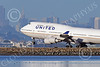 B747 01545 A Boeing 747 United Airline N171UA lands at SFO with San Francisco's skyline as background airliner picture by Peter J Mancus