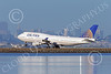 B747 01557 A Boeing 747 United Airline N171UA lands at SFO with San Francisco's skyline as background airliner picture by Peter J Mancus