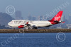 B747 01511 A Boeing 747 Virgin Atlantic G-VROC rolls out after landing at SFO with San Francisco's skyline in the background airliner picture by Peter J Mancus