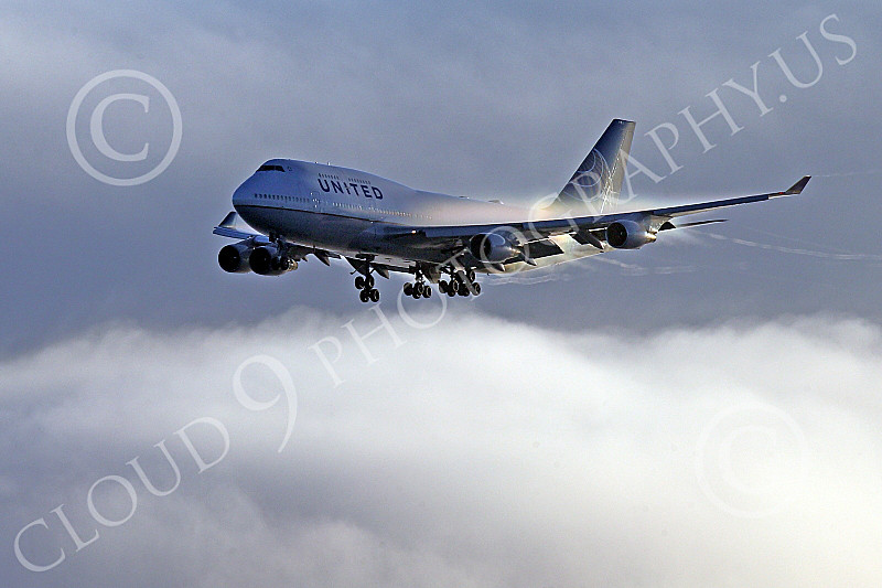 B747 01522 A Boeing 747 United Airline flying through moist air with vapor and vortex airline picture by Peter J Mancus