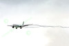 B777P 00575 A Boeing 777 ANA Airline on final approach to land at SFO 12-2014 with long wavy vapor trails airliner picture by Peter J Mancus