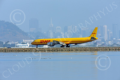 DC-8-C 00036 A DHL Douglas DC-8 jet, N801DH, rolling out after landing at SFO with San Francisco in the background, by Peter J Mancus