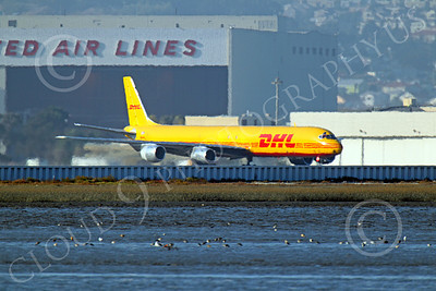 DC-8-C 00012 A DHL Douglas DC-8 jet taxis for take-off at SFO, by Peter J Mancus