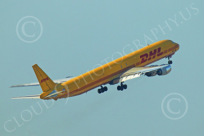 DC-8-C 00021 A DHL Douglas DC-8 jet, N801DH, climbs out after taking off, by Peter J Mancus