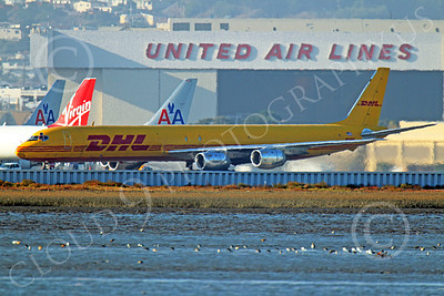 DC-8-C 00017 A DHL Douglas DC-8 jet, N801DH, taxis for take-off at SFO, by Peter J Mancus