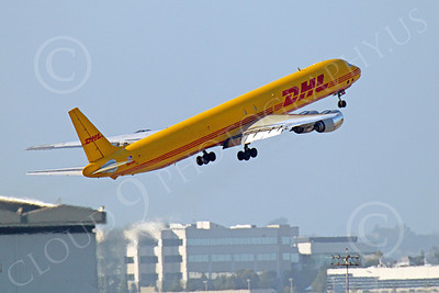 DC-8-C 00015 A DHL Douglas DC-8 jet, N801DH, climbing after taking-off at SFO, by Peter J Mancus