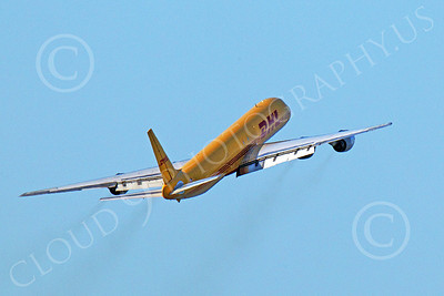 DC-8-C 00025 Top quarter rear view of a climbing out DHL Douglas DC-8 jet, N801DH, by Peter J Mancus